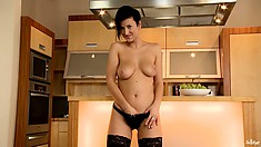 Femme fatale in black clothes shows how horny she is during manual exercises