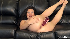 She slides that dildo deep in her peach and her sighs of pleasure fill the room