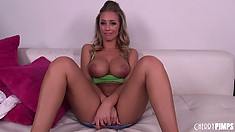 Stunning blonde Nicole Aniston reveals her sublime boobs and hot legs on the couch