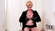 Piercing kink playing with the iron studs in her pink nipples