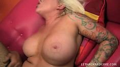 Inked up blonde with a big phat butt gets down with a huge cock