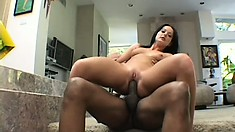 Hot brunette can't hide her excitement for having two black rods drilling her holes