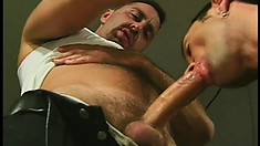 A couple of gay hunks lick up the results of their cock sucking ass action
