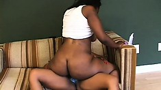 Sexy black lesbians eat out each other's cunts and have fun with a strap-on dildo