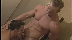 Muscular dude gets into a sweaty fuck fest with another dude