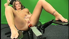 Busty blonde spreads her hot legs and a fucking machine drills her twat