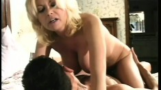 Stacked blonde milf has a stud drilling her snatch all over the bed